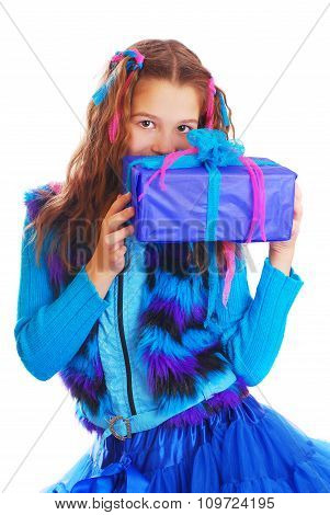 Surprised girl with a gift on an isolated background