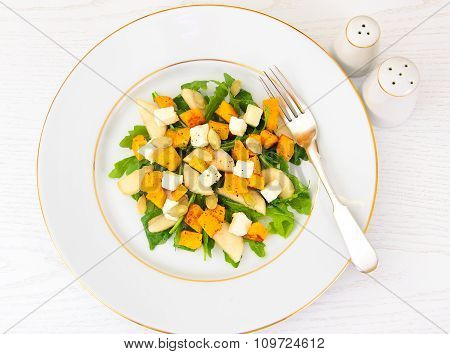 Healthy and Diet Food: Salad, Pumpkin, Pear, Cheese and Seeds.