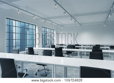 Workplaces In A Bright Modern Loft Open Space Office. Empty Tables And Docents' Book Shelves. Singap