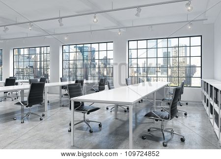 Workplaces In A Bright Modern Loft Open Space Office. Empty Tables And Docents' Book Shelves. New Yo