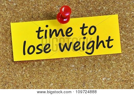 Time To Lose Weight Word On Yellow Notepaper With Cork Background