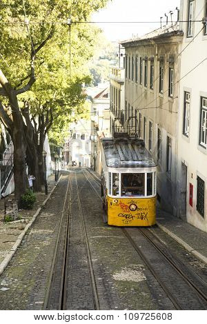 LISBON-PORTUGAL NOVEMBER 11, 2015:  In operation since 1873, The Lisbon tramway network serves the municipality of Lisbon, Portugal.  Yellow tramway are popular with the tourists.