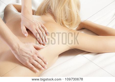 Woman Giving Back Massage To A Girl