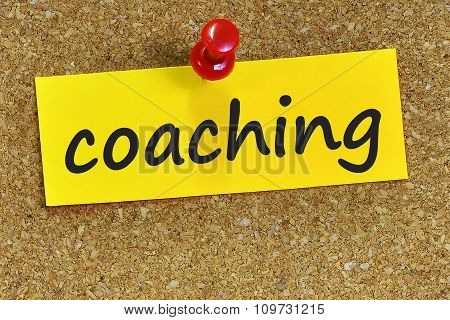 Coaching Word On Yellow Notepaper With Cork Background