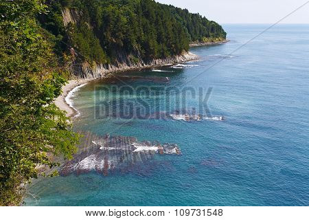 Amazing view from the high rock on beautiful seashore with reefs