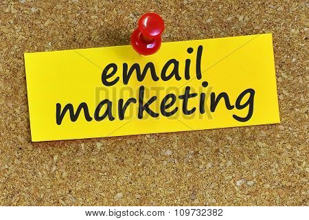 Email Marketing Word On Yellow Notepaper With Cork Background
