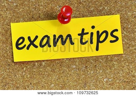 Exam Tips Word On Yellow Notepaper With Cork Background