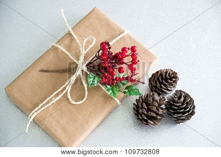 Christmas Gift  And Pine Cones On A Silver Background