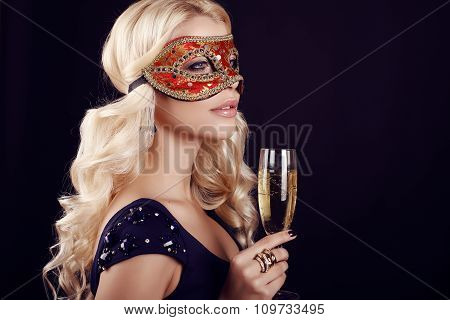 Beautiful Blond Woman In Carnival Mask,with Glass Of Champagne