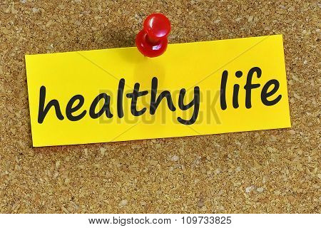 Healthy Life Word On Yellow Notepaper With Cork Background