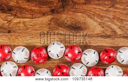 Jingle bells on wooden background