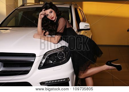 Gorgeous Woman With Dark Hair Wears Luxurious Dress,posing Beside White Car