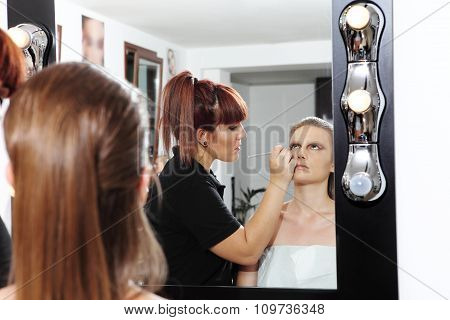 Makeup Artist Applying Mascara On Eyes Of Model