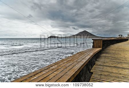 Wooden walkway on the beach in bad weather at Tenerife, Canary Islands, Spain