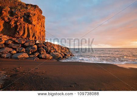 Tropical beach with volcanic sand in sunset time at Tenerife, Canary Islands, Spain