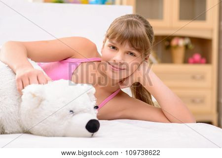 Pretty little girl resting at home