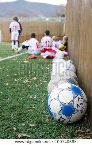 Old Soccer Balls On Artificial Turf Floor