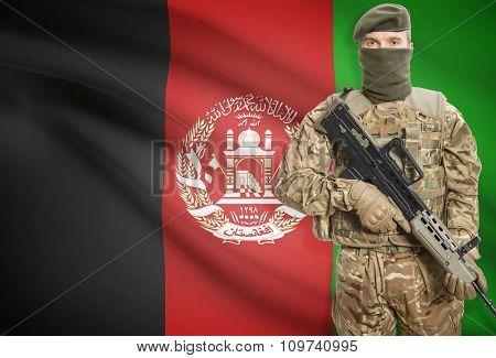Soldier Holding Machine Gun With Flag On Background Series - Afghanistan