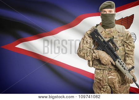Soldier Holding Machine Gun With Flag On Background Series - American Samoa