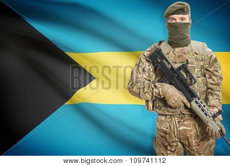 Soldier Holding Machine Gun With Flag On Background Series - Bahamas
