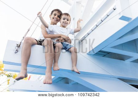 Happy kids spending holiday vacation in beautiful resort