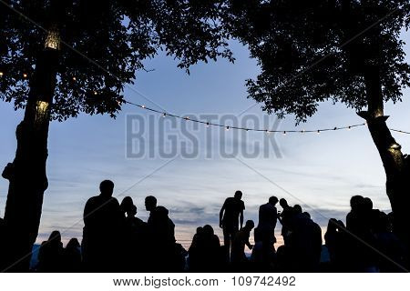 Crowd people together outdoor waiting for sunset