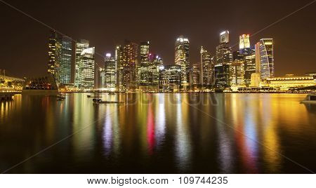 SINGAPORE - CIRCA APR, 2012: Night panorama of the skyscrapers of business district Marina Bay in Singapore with water reflections.