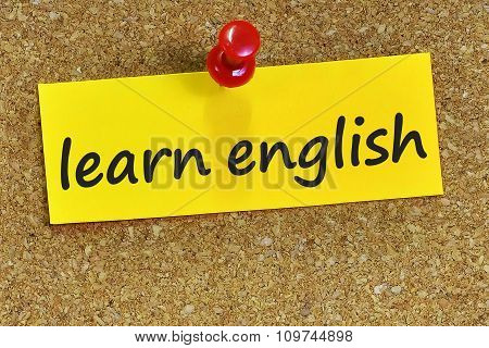 Learn English Word On Yellow Notepaper With Cork Background