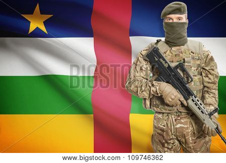Soldier Holding Machine Gun With Flag On Background Series - Central African Republic