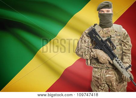Soldier Holding Machine Gun With Flag On Background Series - Congo-brazzaville