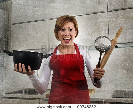 young attractive rookie home cook woman in red apron at home kitchen holding cooking pan and rolling