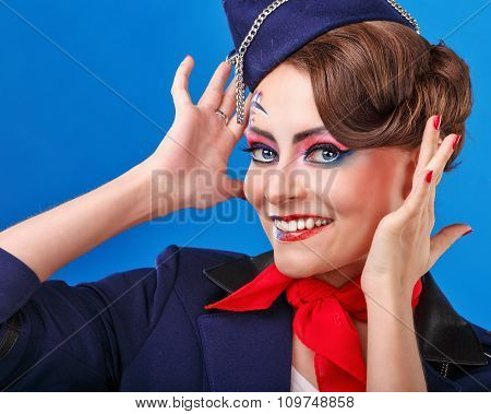 Stewardess With Face Art Corrects Hairstyle.