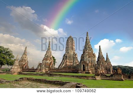 Old pagoda with cloudy sky and rainbow in Thailand