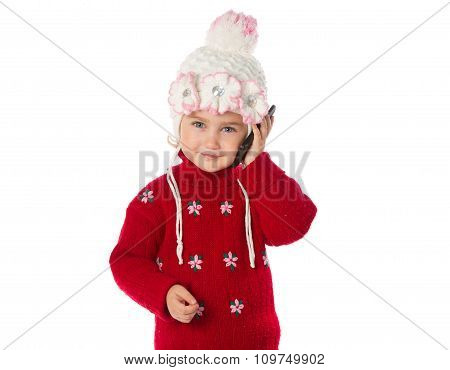 A Little Girl In A Red Sweater Talking On The Phone On A White Background.
