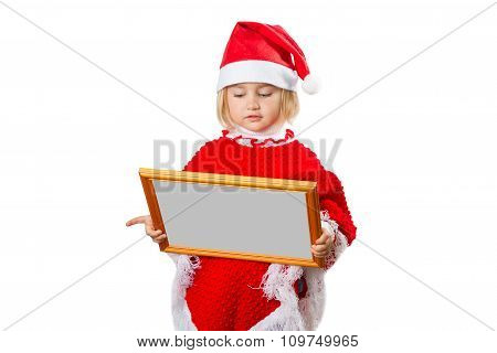 Little Girl In Hat Santa Claus Holding Frame With A Gray Background