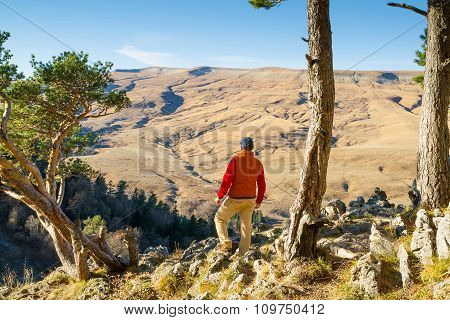 Male Tourist Looking At Panoramic Autumn Landscape