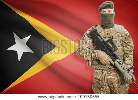 Soldier Holding Machine Gun With Flag On Background Series - East Timor
