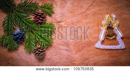 Christmas Tree A Green Twig And A Bell On Wooden Old Rustic Background. New Year