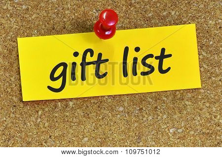 Gift List Word On Yellow Notepaper With Cork Background