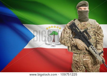 Soldier Holding Machine Gun With Flag On Background Series - Equatorial Guinea
