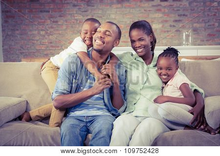 Happy family relaxing on the couch in living room