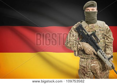 Soldier Holding Machine Gun With Flag On Background Series - Germany