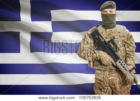 Soldier Holding Machine Gun With Flag On Background Series - Greece