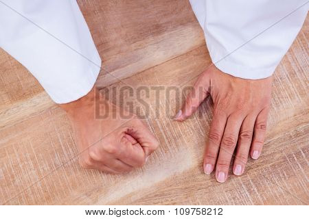 View of hand with clenched fist on desk
