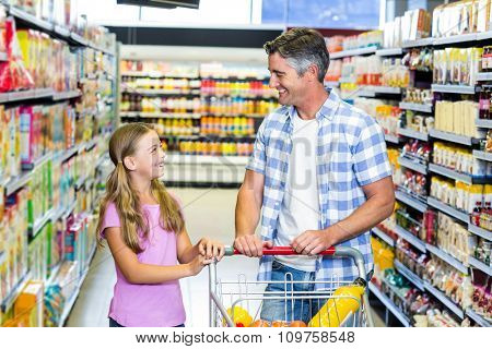 Father and daughter talking at the supermarket