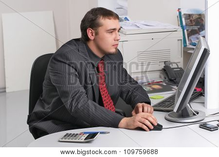 Businessman in office working with PC
