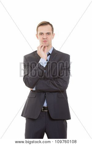 body language. man in business suit isolated on white background. stroking the chin,