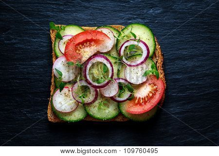Vegetarian toast, sandwich with vegetables top view