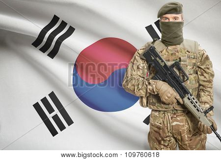 Soldier Holding Machine Gun With Flag On Background Series - South Korea