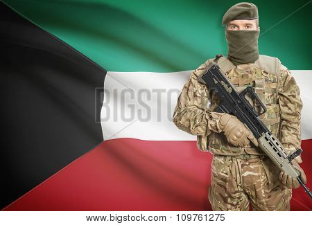 Soldier Holding Machine Gun With Flag On Background Series - Kuwait